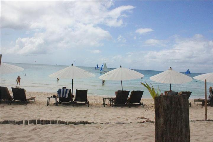 """""""还有就是长滩岛的贝壳以洁白、透明和形态美丽而著名,尤其是小贝壳非常适合用来做项链。星期五海滩_星期五海滩""""的评论图片"""